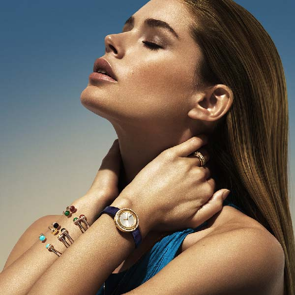 Doutzen Kroes wears Piaget Possession gold bracelets and a luxury watch